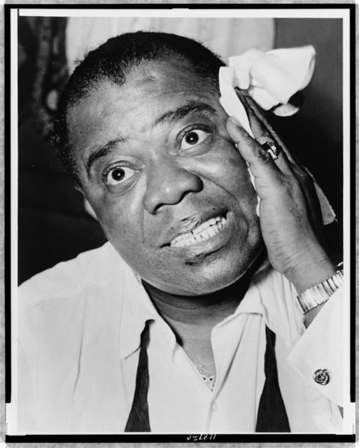 [Louis Armstrong, head-and-shoulders portrait, facing front] / World Telegram & Sun photo by Herman Hiller.