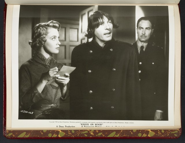 "[ Mai Zetterling (taking notes), Danny Kaye (in wig) and man in uniform watching them - scene from ""Knock on Wood""]"