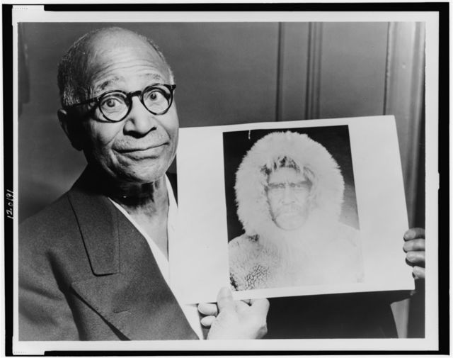 [Matthew Henson, head-and-shoulders portrait, facing front, holding a portrait of Robert E. Peary taken during an expedition to the North Pole] / World-Telegram photo by Roger Higgins.