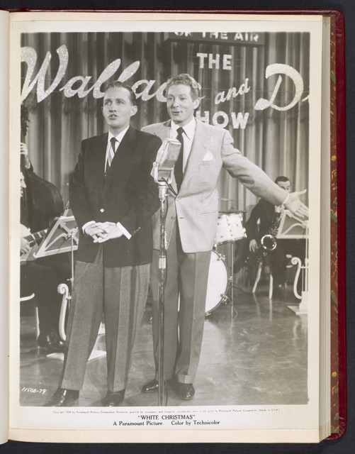 "[ Bing Crosby and Danny Kaye singing onstage with a band - scene from ""White Christmas""]"