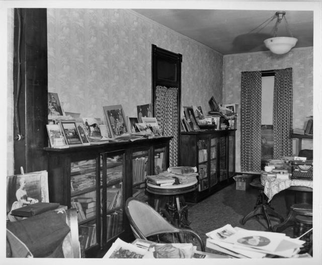 [Interior of L.C. Handy Studio, 494 Maryland Ave., SW,Washington, D.C.,with prints dating back to Mathew Brady displayed on bookcases and tables] / photograph by the Library of Congress.