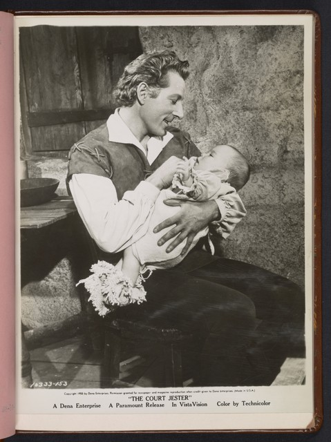 "[ Danny Kaye holding a baby - scene from ""The Court Jester""]"
