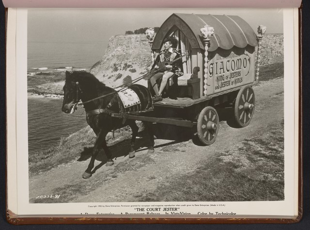 "[ Danny Kaye on horse drawn carriage - scene from ""The Court Jester""]"
