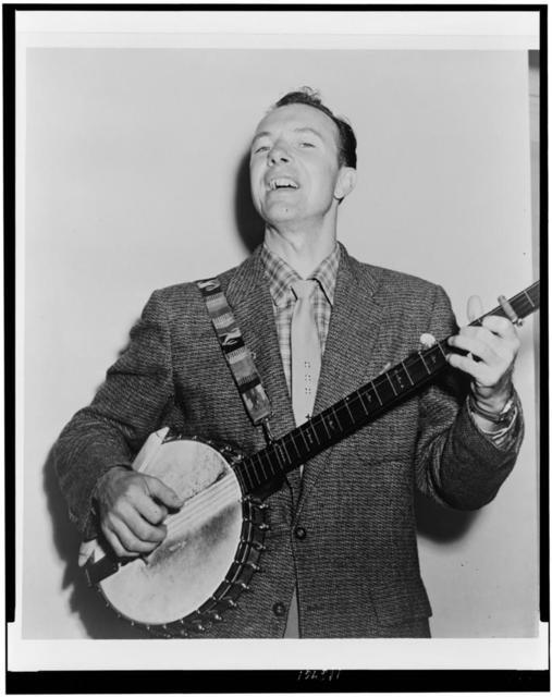 [Pete Seeger, half-length portrait, singing while playing banjo] / World Telegram & Sun photo by Fred Palumbo.