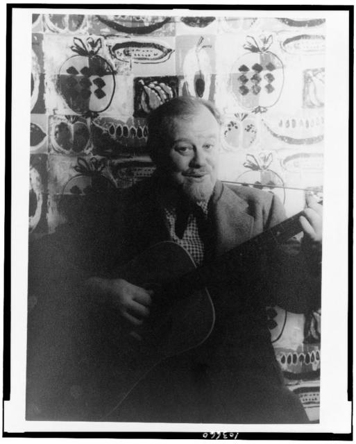 [Portrait of Burl Ives, holding guitar]