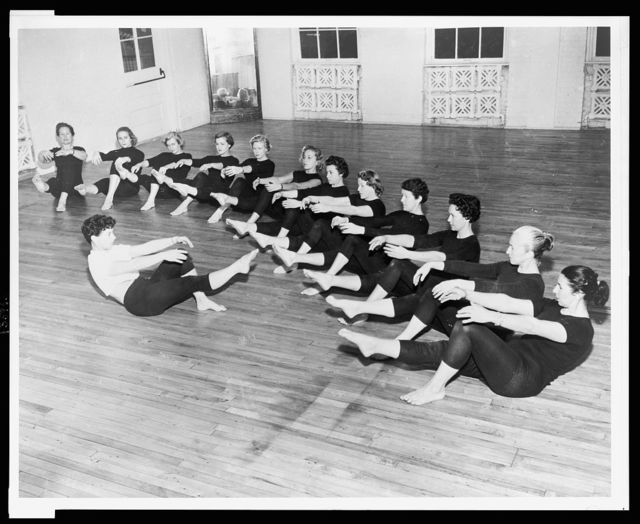Bonnie Prudden leads a class in exercises at her White Plains school / World Telegram & Sun photo by Al. Ravenna.