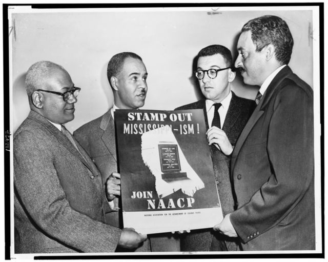 Holding a poster against racial bias in Mississippi are four of the most active leaders in the NAACP movement, from left: Henry L. Moon, director of public relations; Roy Wilkins, executive secretary; Herbert Hill, labor secretary, and Thurgood Marshall, special counsel / World Telegram & Sun photo by Al. Ravenna.