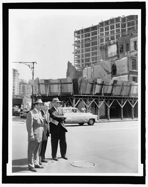 [Mayor Robert Wagner (r) joined by Robert Moses (l) and Frank Meistrell (c) on a housing project tour] / World-Telegram photo by Walter Albertin.