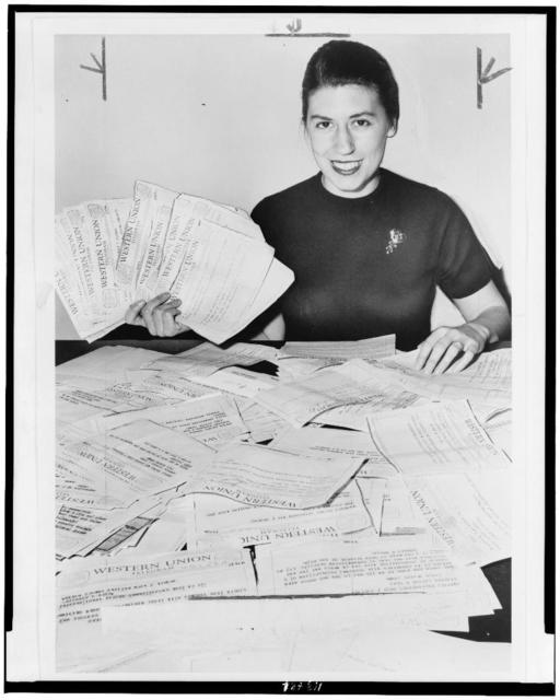 [Secretary with telegrams pledging over $100,000.00 to International Rescue Committee] / World Telegram & Sun photo by Ed. Ford.