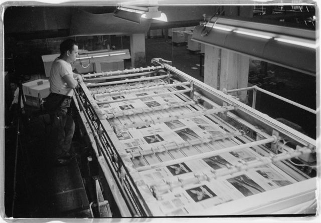 [U.S. News & World Report employee working on producing an issue of the magazine at the presses and plate making room in the production plant, Dayton, Ohio] / [TOH].