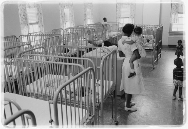 [A woman holding a child in the nursery at Junior Village, Washington, D.C.] / [WKL].