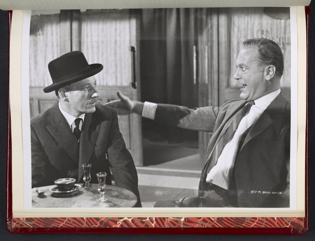 "[ Curd Jurgens gesturing to Danny Kaye at a table - scene from ""Me and the Colonel]"