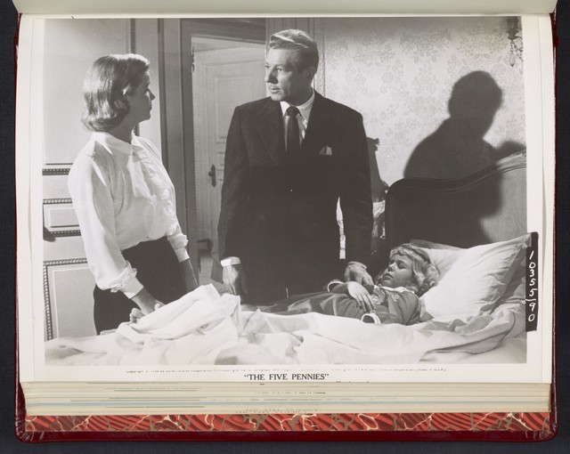 "[ Danny Kaye and Barbara Bel Geddes standing at the bedside of Susan Gordon - scene from ""The Five Pennies""]"
