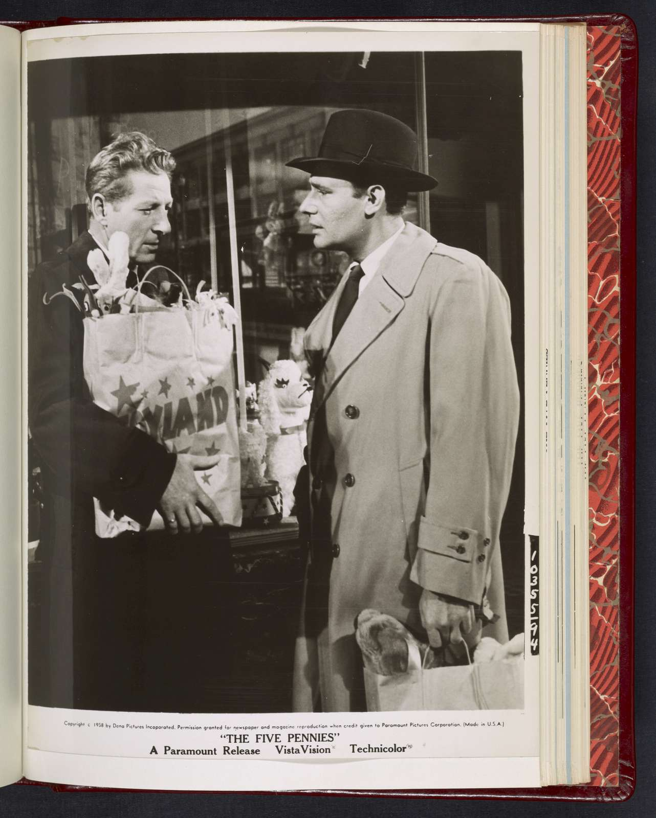 """Danny Kaye and Harry Guardino holding shopping bags filled with toys - scene from """"The Five Pennies"""""""