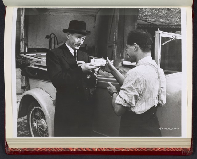 "[ Danny Kaye handing papers to a man - scene from ""Me and the Colonel""]"