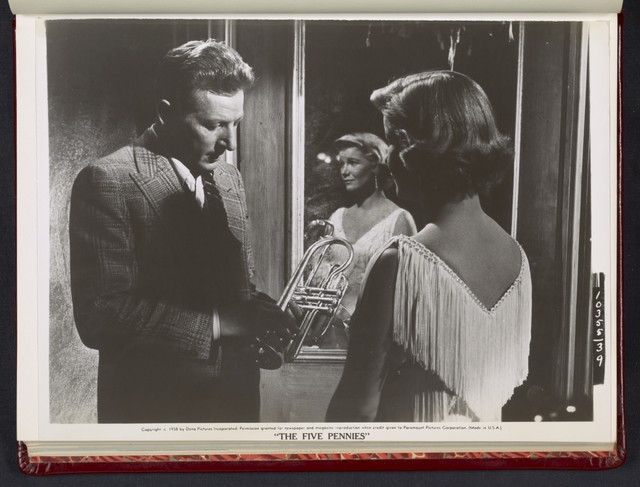 "[ Danny Kaye inspecting trumpet with Barbara Bel Geddes - scene from ""The Five Pennies""]"