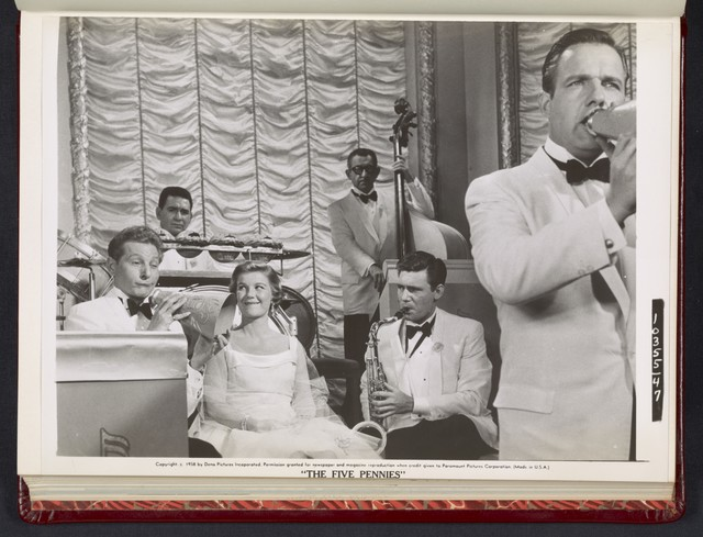 "[ Danny Kaye making humorous face while holding a megaphone on stage - scene from ""The Five Pennies""]"