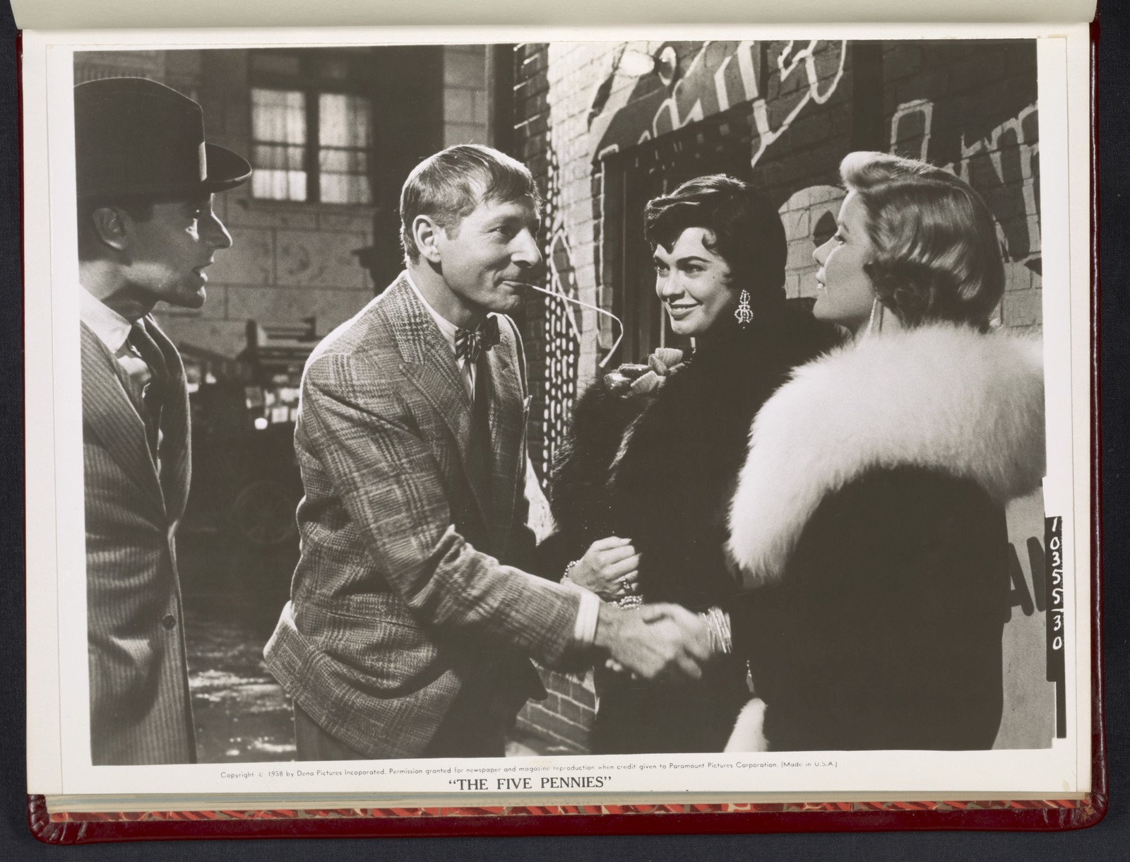 """[ Danny Kaye shaking hands with woman - scene from """"The Five Pennies""""]"""