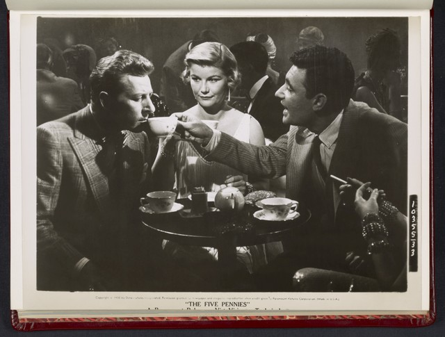 "[ Danny Kaye sipping drink at table with Barbara Bel Geddes and man - scene from ""The Five Pennies""]"