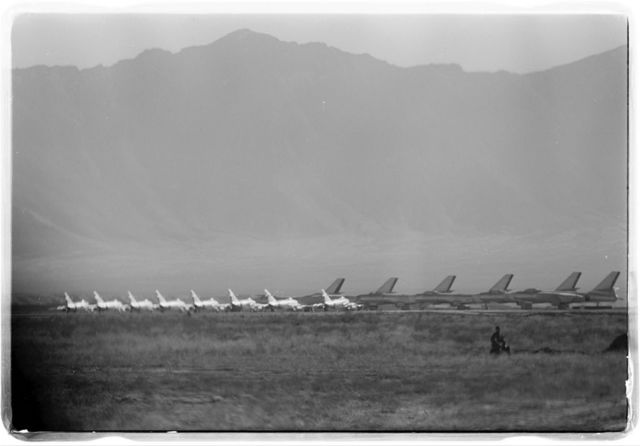 [Rows of airplanes on an air field surrounded by grasslands and mountains in Kabul, Afghanistan, during President Eisenhower's visit] / [TOH].