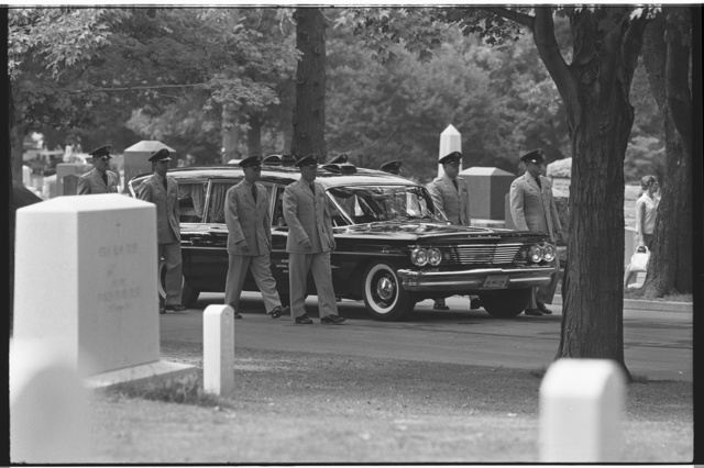 [Military personnel escorting a hearse, at the Arlington National Cemetery burial of Willard G. Palm, a RB-47 reconnaissance airplane pilot who was shot down by the Russians] / MST.