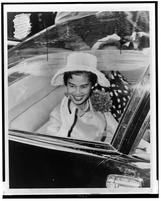 [Queen Sirikit of Thailand, seated in car, waving, probably during ticker tape parade, New York City] / World Telegram & Sun photo by Phil Stanziola.