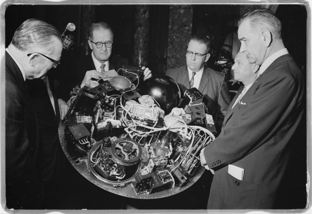William G. Stroud of NASA, project manager of the TIROS I, displaying the satellite circuitry to Lyndon B. Johnson and others / [WKL].