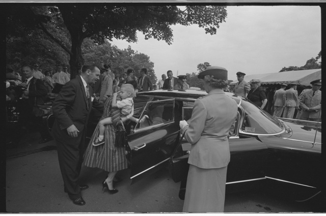 [Woman holding a child and getting into a car at the Arlington National Cemetery burial of Willard G. Palm, a RB-47 reconnaissance airplane pilot who was shot down by the Russians] / JTB.