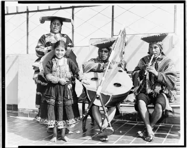 [Four Quechua Indians (l to r) Maria Palimino; her sister Raymunda; Juan Quispe, harp player; and Justino Roca, flute player at Empire State Building] / World Telegram & Sun photo by Walter Albertin.