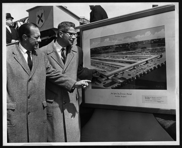 [New York City Mayor Wagner and U.S. Secretary of Agriculture Orville Freeman look at architect's drawing of new Hunts Point Market during ground breaking ceremonies in the Bronx] / World Telegram & Sun photo by Al Ravenna.