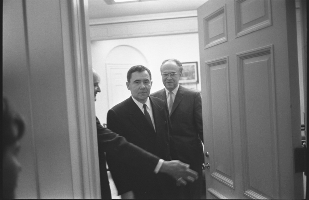 [Soviet foreign minister Andrei Gromyko and  Soviet Ambassador to the United States, Anatoly F. Dobrynin, walking through a door way at the White House, Washington, D.C.]