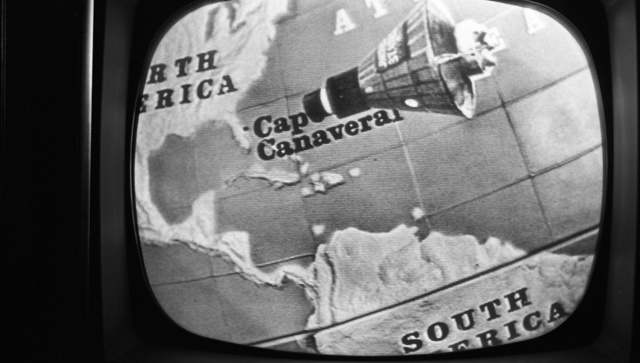[Television screen showing depiction of John Glenn's Friendship 7 space capsule approaching North America, during his orbit around earth on February 20, 1962]