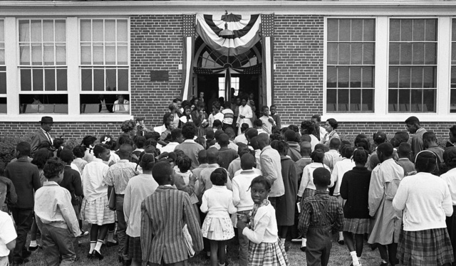[African American school children entering the Mary E. Branch School at S. Main Street and Griffin Boulevard, Farmville, Prince Edward County, Virginia]