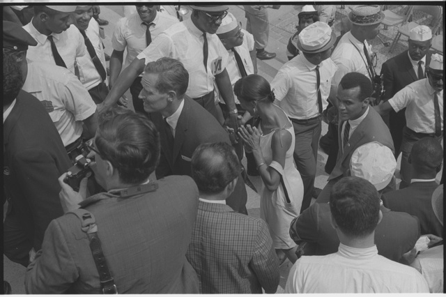 [Charlton Heston and Harry Belafonte walking past marshals at the Lincoln Memorial during the March on Washington,1963]