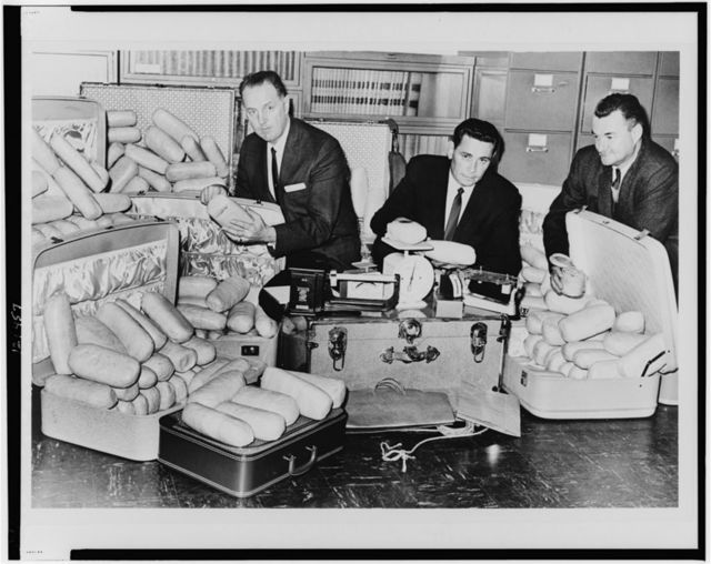 Narcotics agents with over 400 lbs. of marijuana / World Telegram & Sun photo by Ed Ford.