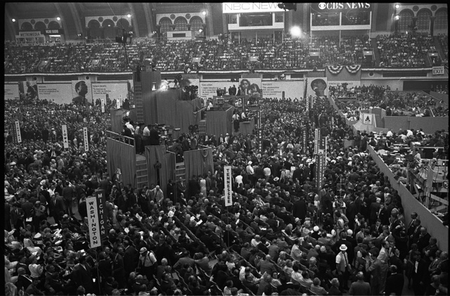 [Aerial view of delegates seated on the floor of the 1964 Democratic National Convention, Atlantic City, New Jersey; television crews and booths also visible] / WKL.