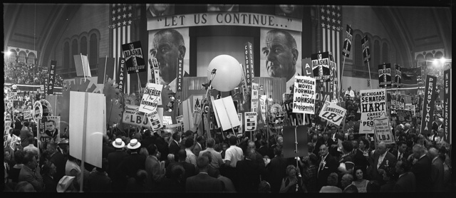 "[Delegates and stage at the 1964 Democratic National Convention, Atlantic City, New Jersey; sign over stage reads ""Let us continue...""]"