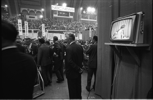 [Delegates with state signs and a television screen at the 1964 Democratic National Convention, Atlantic City, New Jersey] / TOH