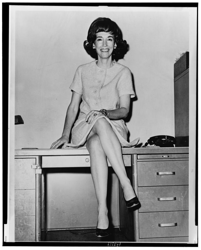 [Helen Gurley Brown, full-length portrait, sitting on a desk] / World Telegram & Sun photo by John Bottega.