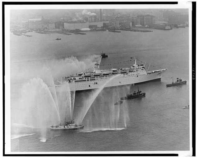 "[Israeli luxury liner ""Shalom"" arriving in New York City escorted by tugboats spraying plumes of water] / World Telegram & Sun photo by Dick DeMarsico."