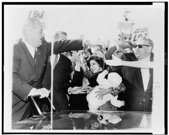 [Pres. Lyndon B. Johnson reaches hand out to greet crowd of supporters at Bergen Mall] / World Telegram & Sun photo by Dick DeMarsico.