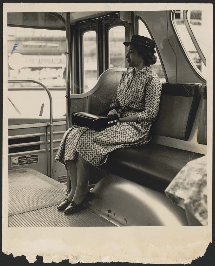 [Rosa Parks seated at the front of a bus in a staged portrait taken after the Montgomery bus boycott]