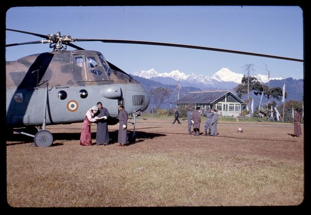 [King and Queen of Sikkim getting ready to fly to Bhutan in helicopter, Sikkim]