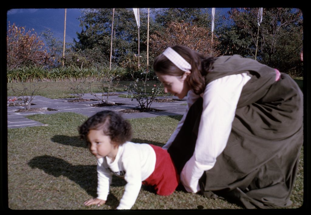 [Queen and Prince of Sikkim playing outdoors, Sikkim]