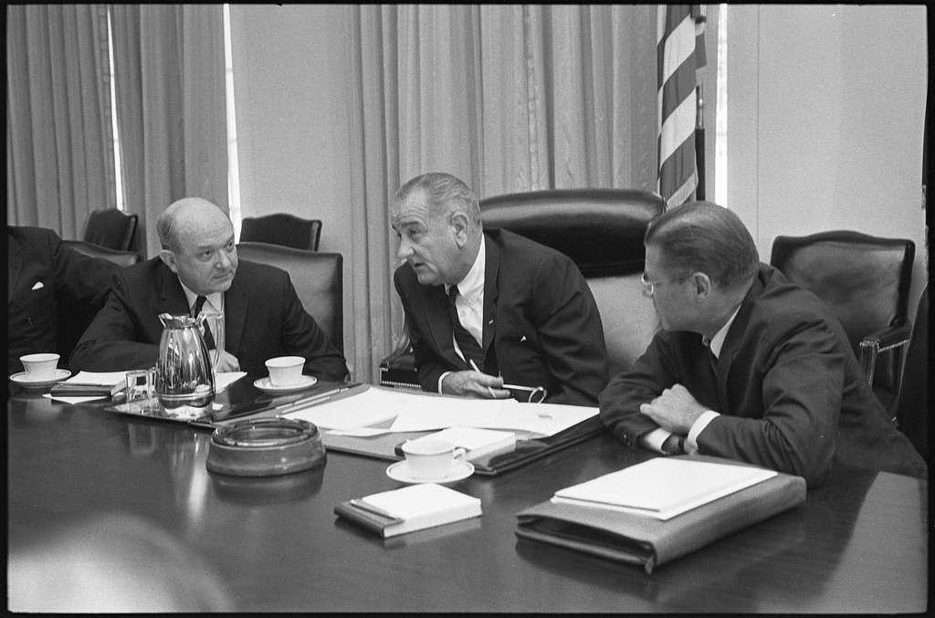 Secretary of Defense Robert McNamara (right), President Lyndon Baines Johnson and Secretary of State Dean Rusk, seated at a table after McNamara's return from South Vietnam WKL