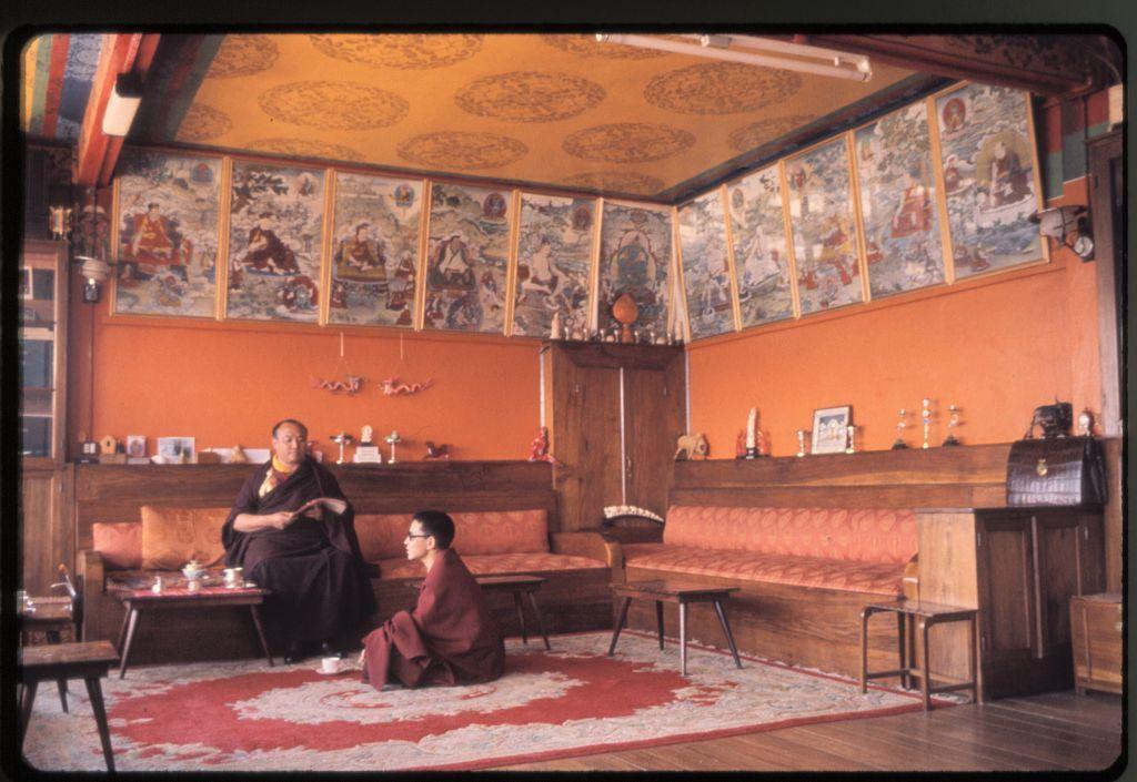 [The sixteenth Karmapa Lama (Rangjung Rigpe Dorje), with monk, at Rumtek Monastery, Sikkim]