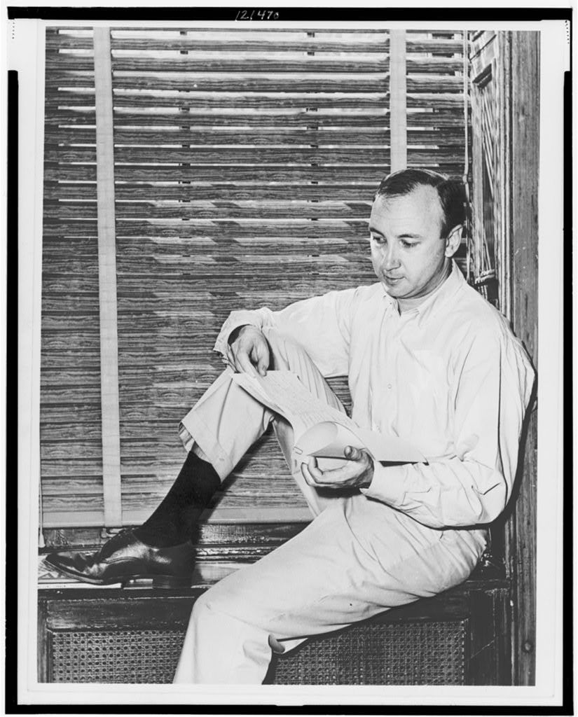 Mr. Neil Simon, author, sitting on windowsill at home pouring over a script of play he wrote / World Telegram & Sun photo by Al Ravenna.