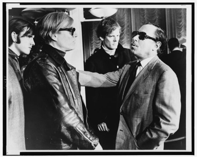 [Andy Warhol (left) and Tennessee Williams (right) talking on the S.S. France] / World Journal Tribune photo by James Kavallines.
