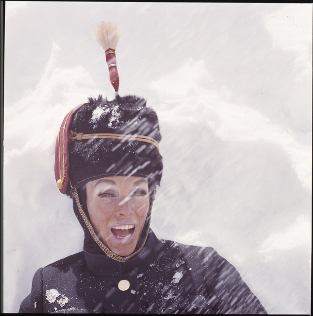 [Ann Bonfoey Taylor, head-and-shoulders portrait, in snow, wearing a ski outfit including a military hat and googles, Colorado]