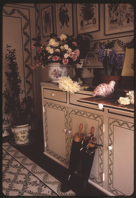[Flower arrangements, a ceramic bird and flower pots on the counter of a cupboard in the home of Ann Bonfoey Taylor, Denver, Colorado]